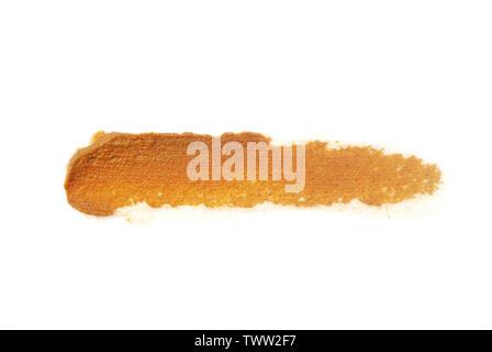 Detox the skin with turmeric.Smear cream .Apply cream with turmeric.Turmeric crushed skin. - Stock Photo