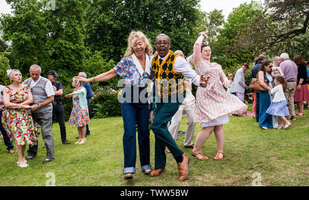 Energetic couple dancing and having fun on 1940s Day, Harrogate, England, UK, 23rd June 2019.