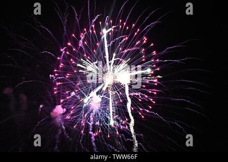 Firework celebrations in the night sky - Stock Photo