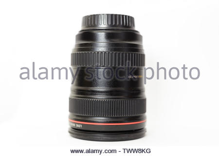 A photo zoom lens placed in a vertical position on a white background - Stock Photo