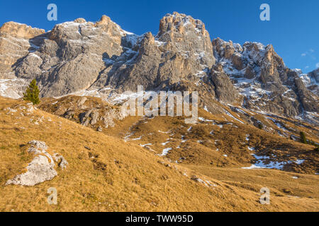 Golden hour in Italy's Dolomites, long hike in the mountains, autumnal landscapes in the alpine. Imposing rock faces of the Pale di San Martino. - Stock Photo