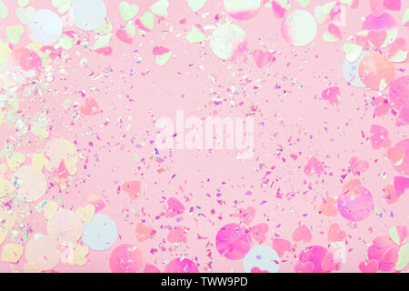 Festive frame of colorful Confetti and sparkles on pink pastel trendy background. - Stock Photo