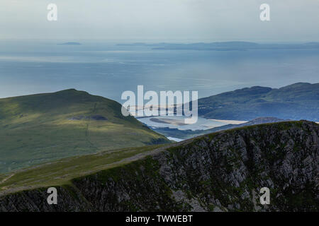 The view from the top of Cadair Idris, or Cadar Idris, a mountain in the Southern Snowdonia National Park in Wales, looking towards Barmouth. - Stock Photo