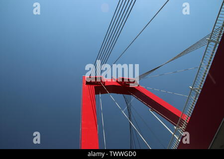 Red colored Willemsbrug over river Nieuwe Maas in Rotterdam, the Netherlands - Stock Photo