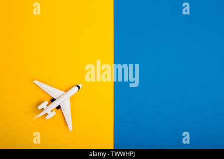 bright colorful background with airplan. Flat lay - Stock Photo