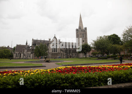 St Patrick's Cathedral from across the flower gardens, Dublin, Ireland - Stock Photo