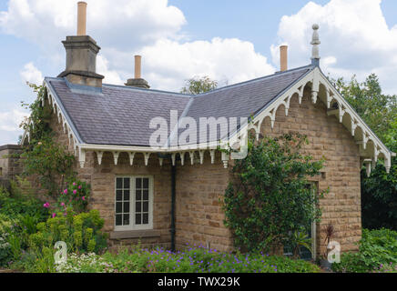 SHEFFIELD, UK - 22ND JUNE 2019: A small idylic house sits inside the Botanical Gardens, taken on a bright sunny day in Summer - Stock Photo
