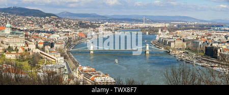 BUDAPEST, HUNGARY - MARCH 2018: Panoramic view of the River Danube and the Chain Bridge in Budapest with the city in the background. - Stock Photo