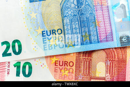 Euro banknotes in detail on table. bills of different denominations - Stock Photo