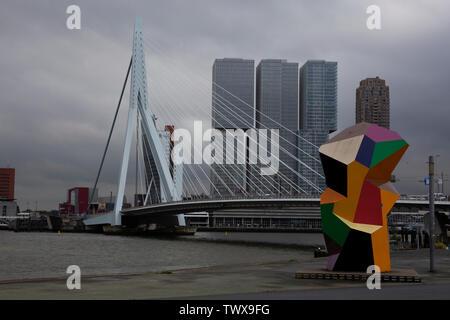 The Erasmus Bridge over the Nieuwe Maas River with the De Rotterdam building, and sculpture - Marathon - by Henk Visch Rotterdam, Netherlands - Stock Photo