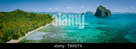 Panoramic drone aerial view of coastal scenery from the mainland Palawan with tropical Pinagbuyutan islands on horizon. El Nido-Philippines. Best - Stock Photo
