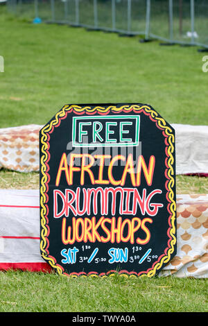 Free African Drumming Lessons workshops, handmade sign at Africa Oye, Liverpool, UK - Stock Photo
