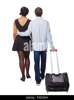 Back view of interracial going couple with suitcase. Rear view people collection. backside view of person. Isolated over white background. Young peopl - Stock Photo