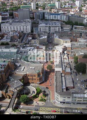 'Looking across the Broadmead Shopping Centre, Bristol, from a static balloon at 500 feet. Left central is the complex glass roof of the Galleries indoor shopping centre. In the centre of the picture is the Hub, a circular open space used for entertainments. Immediately above the Hub is Debenhams department store. The boat-shaped House of Fraser store is to the left of Debenhams (the words House of Fraser can be read on the 1672px picture).; the 1672 July 2005 ( 16 July 2005(according to Exif data)); Photographed by Adrian Pingstone; Adrian Pingstone; ' - Stock Photo