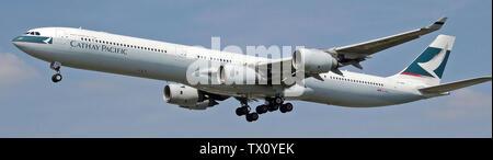 'English: Cathay Pacific Airbus A340-600 (B-HQB) landing at London Heathrow Airport.; 10 August 2007; Own work; Adrian Pingstone (Arpingstone), derivative work Lämpel; ' - Stock Photo