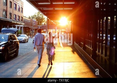 People walking in the Meatpacking District of Manhattan, New York, NY on a warm summer afternoon on the summer solstice (June 21, 2019) - Stock Photo
