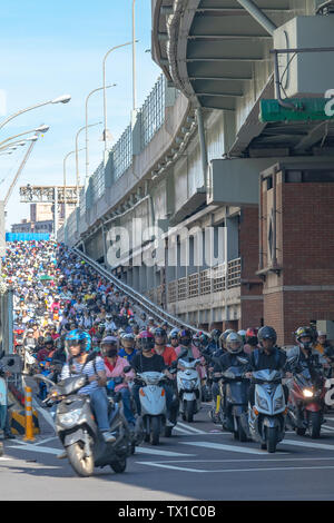 Scooter waterfall in Taiwan. Traffic jam crowded of motorcycles at rush hour on the ramp of Taipei Bridge, Cascade of scooters on Minquan West Road in - Stock Photo