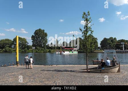 passengers on the passenger ferry on the main river in frankfurt hoechst germany - Stock Photo