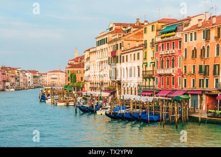 Beautiful view of Grand Canal in Venice,Italy from Rialto bridge with gondolas during sunrise. travel destination - Stock Photo