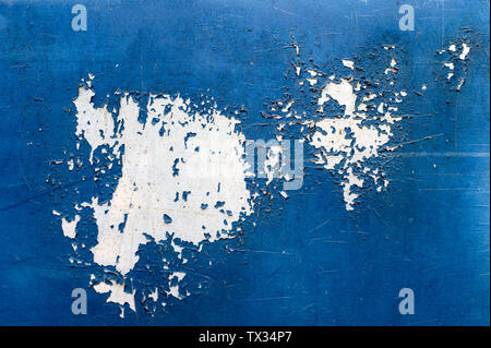 Paint peeling and decay on blue skin of the car background - Stock Photo