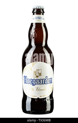 Kiev, UKRAINE - June 11, 2019. Hoegaarden beer bottle on white, Hoegaarden Brewery is a brewery in Hoegaarden, Belgium, and the producer of a well kno - Stock Photo
