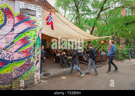 Norway bar, view of young people entering the riverside terrace of Bla - a popular bar/club in alternative Grünerløkka in central Oslo, Norway - Stock Photo