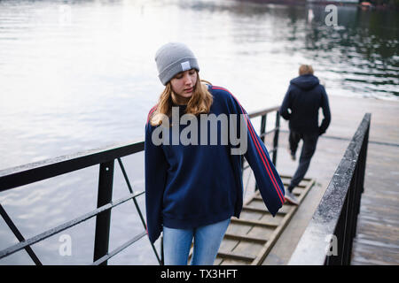 Teenage girl walking up ramp over Shawnigan Lake, British Columbia, Canada - Stock Photo
