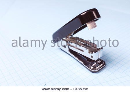 Black stapler isolated on white background. School and office supplies on the desktop. Copy space. The concept of school and preschool education, offi - Stock Photo