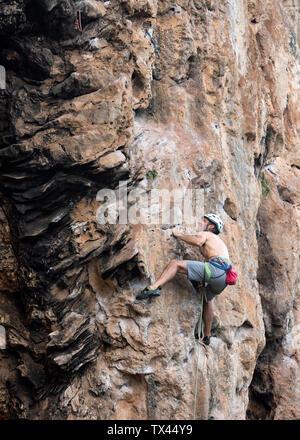Thailand, Krabi, Thaiwand wall, barechested climber in rock wall - Stock Photo