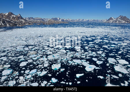 Greenland, East Greenland, Aerial view of Ammassalik island and fjord with pack or drift ice - Stock Photo