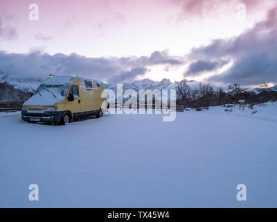 Spain, Asturia, Picos de Europa, van at Mirador De Piedrashistas in winter - Stock Photo