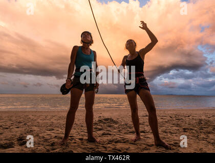 Thailand, Krabi, Lao Liang island, two female climbers discussing on the beach - Stock Photo