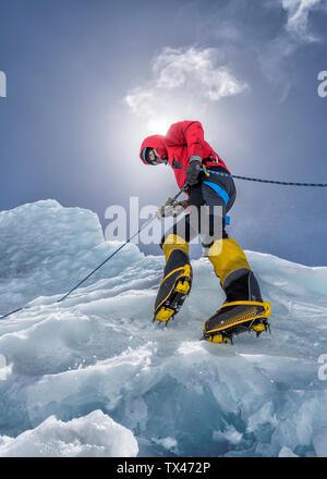 Nepal, Solo Khumbu, Everest, Mountaineers climbing on icefall - Stock Photo