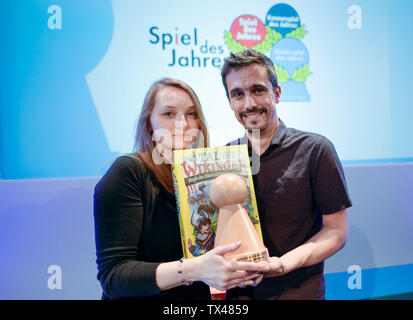Hamburg, Germany. 24th June, 2019. Wilfried and Marie Fort, French game developers, show the board game 'Valley of the Vikings' developed by them. The game won first place at the Children's Game of the Year awards ceremony. Credit: Axel Heimken/dpa/Alamy Live News - Stock Photo