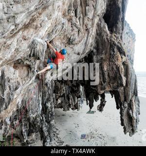 Thailand, Krabi, Lao liang island, climber in rock wall - Stock Photo