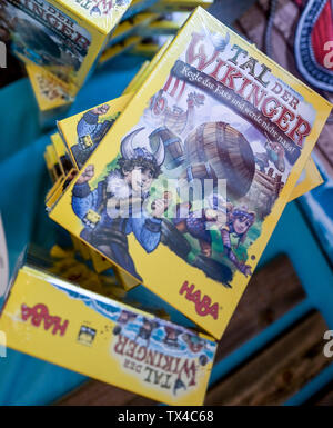 Hamburg, Germany. 24th June, 2019. The boxes of the board game 'Valley of the Vikings' are stacked on the floor. It was awarded Child's Game of the Year. Credit: Axel Heimken/dpa/Alamy Live News - Stock Photo