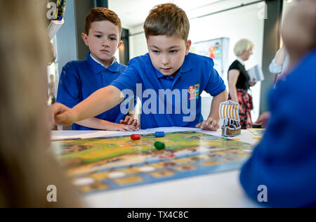 Hamburg, Germany. 24th June, 2019. Children of class 2c of the Wesperloh primary school from the district Osdorf play the board game 'Valley of the Vikings'. It was awarded Child's Game of the Year. Credit: Axel Heimken/dpa/Alamy Live News - Stock Photo