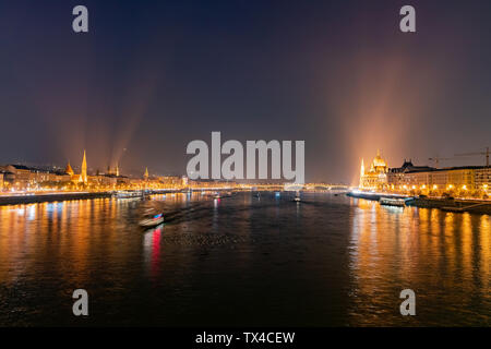 Night view of the Szilágyi Dezső Square Reformed Church and River Danube bank at Budapest, Hungary - Stock Photo