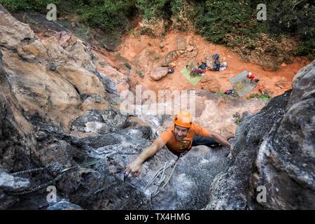 Thailand, Krabi, Thaiwand wall, man climbing in rock wall - Stock Photo