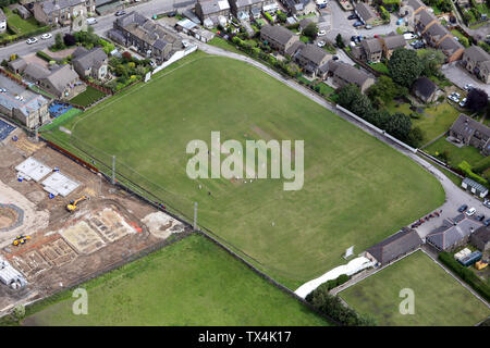 aerial view of cricketers at Golcar Cricket club whilst a match is being played - Stock Photo