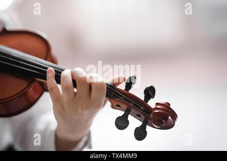 Close-up of girl playing violin