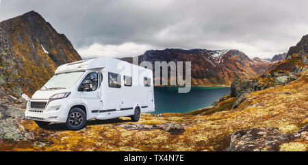 A Caravan or mobile home in front of fjord on Senja Island in Norway - Stock Photo