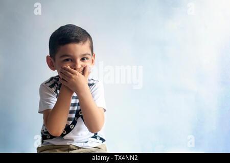 Six years boy portrait. Innocent smiling little boy on grey background. Little kid having fun. People, childhood lifestyle concept. - Stock Photo