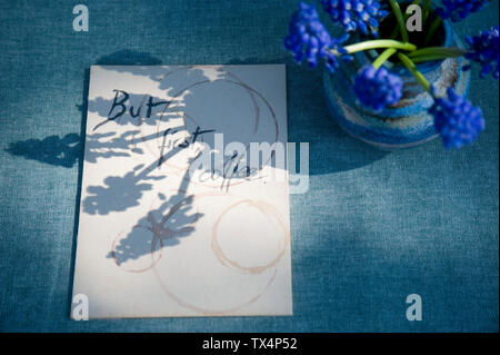 Sign with saying and grape hyacinth - Stock Photo