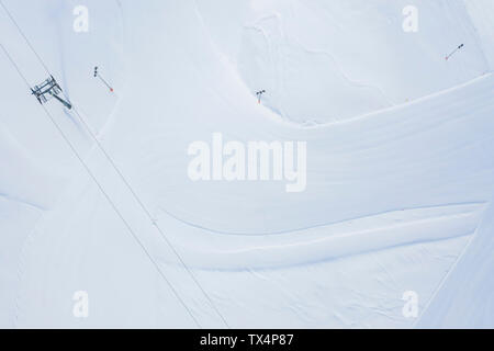 Austria, Tyrol, Galtuer, view to ski slope and chair lift in winter, aerial view - Stock Photo