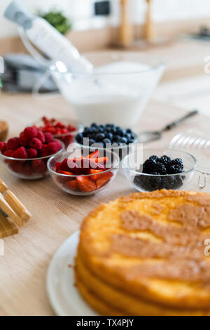 Fresh fruits in bowls for preparing a cake - Stock Photo