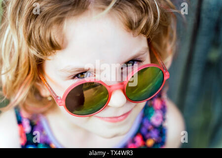 Portrait of little girl wearing sunglasses - Stock Photo