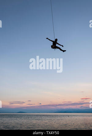 Thailand, Krabi, Lao Liang island, climber abseiling above the sea - Stock Photo