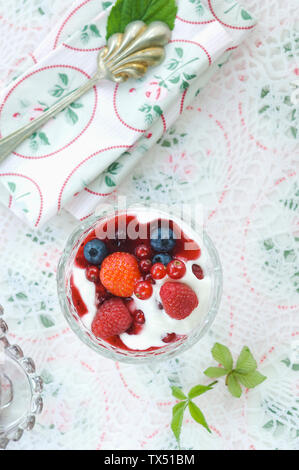 Red Fruit Jelly and natural yoghurt in glass bowl - Stock Photo