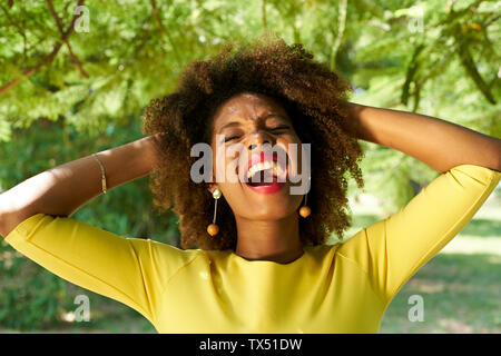 Portrait of young woman screaming for joy